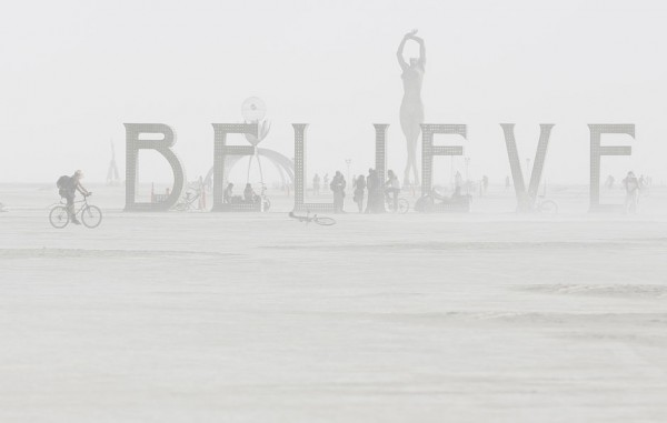Dust envelops art installation during the Burning Man 2013 arts and music festival in the Black Rock Desert of Nevada
