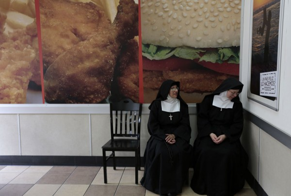 Nuns sit at a fast food restaurant downtown of Guatemala City
