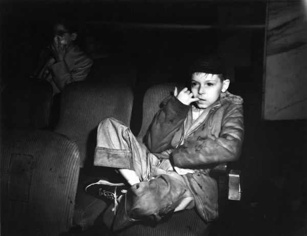 3.-Weegee_Boy-with-finger-in-his-mouth-in-a-movie-theater-New-York