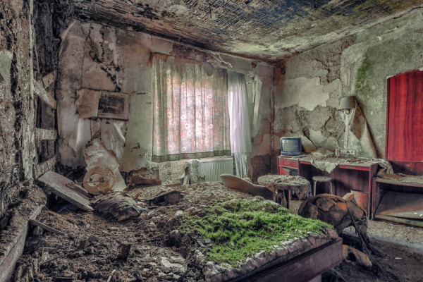 abandoned decay bedroom in a hotel