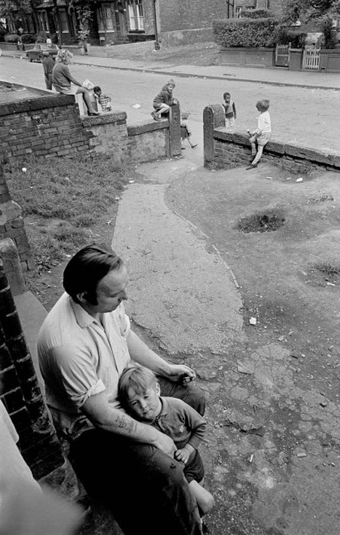 Father-and-son-on-front-porch-of-Manchester-multilet-1972-444-21-652x1024